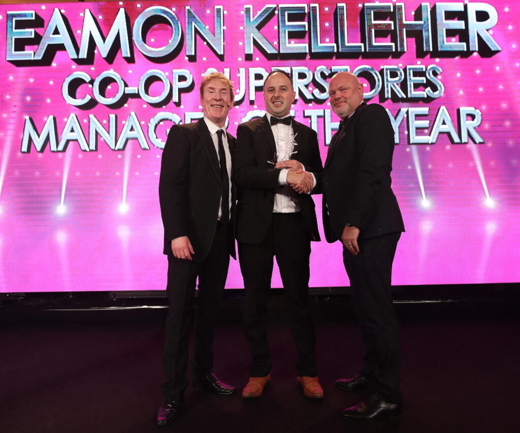CEO Barry Whelan presents the award for Manager of the Year to Eamon Kelleher